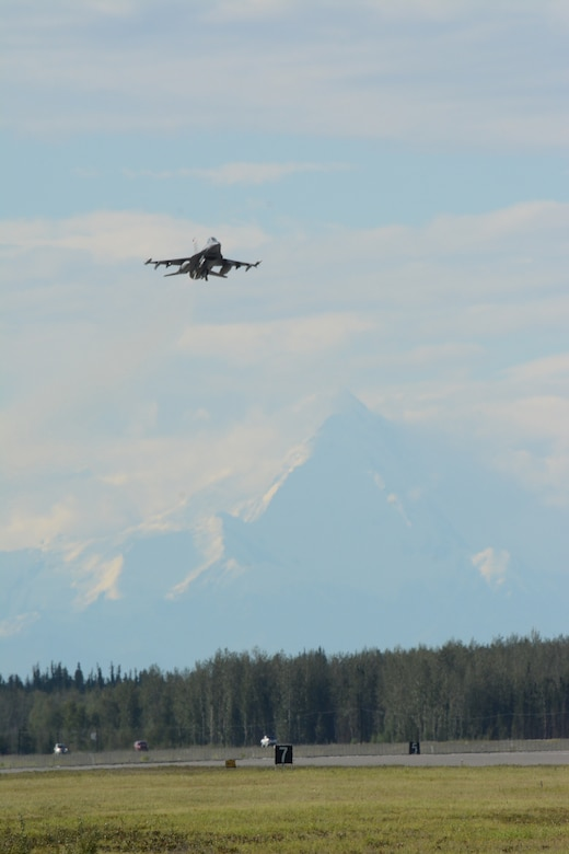 An F-16 Fighting Falcon from the 115th Fighter Wing in Madison, Wis., prepares for landing during the RED FLAG-Alaska exercise at Eielson Air Force Base, Alaska, Aug. 11, 2014. Approximately 130 Airmen from the 115 FW participated in the event, refreshing skills and working in real-world scenarios to test their combat abilities in a high-paced environment. (Air National Guard photo by Staff Sgt. Ryan Roth)