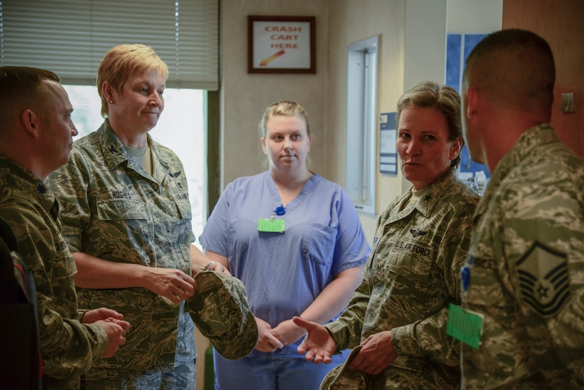 Brig. Gen. Martha Meeker is briefed by 628th Medical Group staff Aug. 21, 2014, at the 628th MDG on Joint Base Charleston, S.C. Meeker was the 628th Air Base Wing commander from January 2010 to July 2011 and has been the vice commander of the U.S. Air Force Expeditionary Center from July 2012 to present. (U.S. Air Force photo/Airman 1st Class Clayton Cupit)