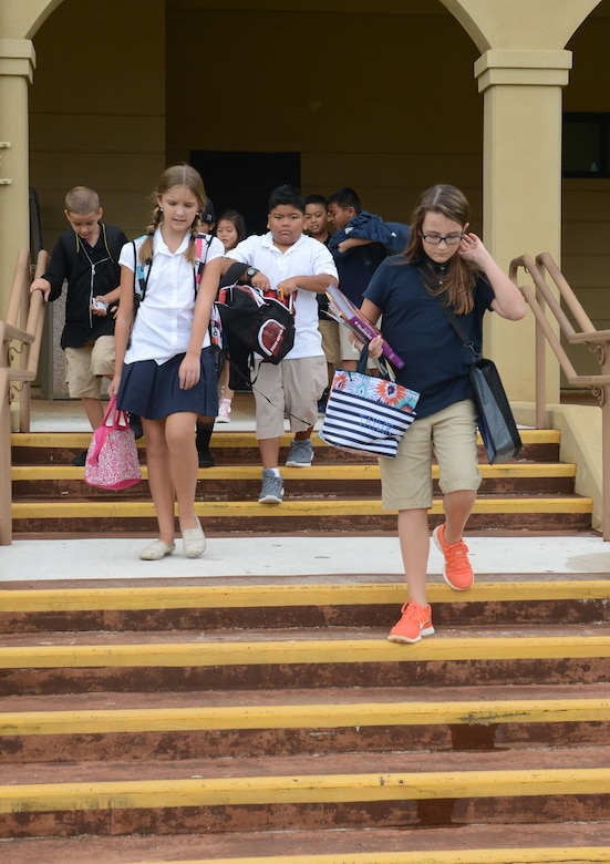 Children of Team Andersen depart Andersen Middle School on Aug. 25, 2014, on Andersen Air Force Base, Guam. Today was the students' first day back from summer break.  (U.S. Air Force photo by Airman 1st Class Adarius Petty/Released)