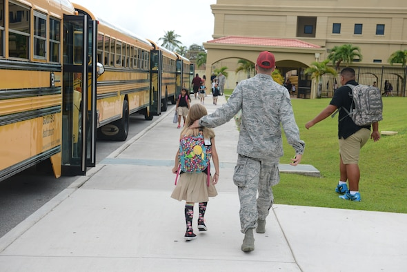 An Airman from the 554th Red Horse Squadron picks up his daughter from Andersen Elementary School Aug. 25, 2014, on Andersen Air Force Base, Guam. Today was the students' first day back from summer break.  (U.S. Air Force photo by Airman 1st Class Adarius Petty/Released)