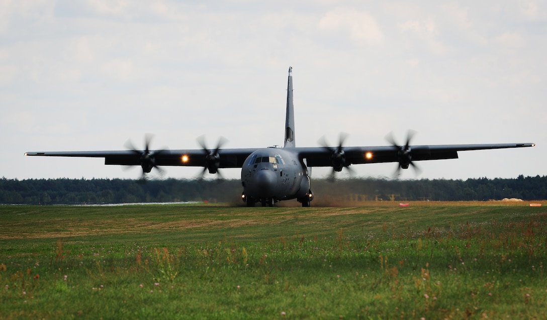 A C-130J Super Hercules lands on an unimproved runway Aug. 25, 2014, at Powidz Air Base, Poland. Throughout the deployment to Poland, Airmen were able to work with NATO partners to develop and improve forces capable of maintaining regional security. (U.S. Air Force photo/Staff Sgt. Jarad A. Denton)