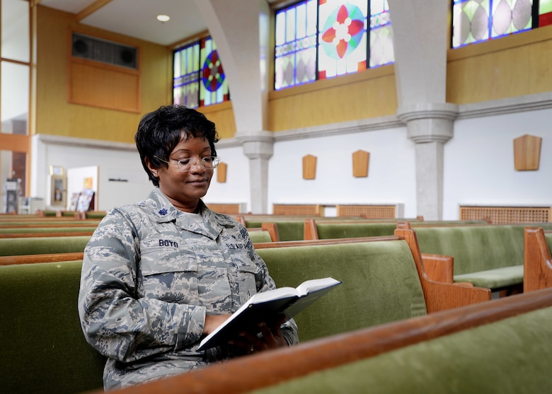 Chaplain (Lt. Col.) Donnette Boyd reads a Bible Aug. 18, 2014, in the pews of the base chapel at Aviano Air Base, Italy. Boyd commissioned into the military in 1987 with no initial intentions of becoming a chaplain. After her experience with three spiritual calls, becoming a chaplain became clear in her future in the Air Force. Boyd is now a 31st Fighter Wing chaplain.  (U.S. Air Force photo/Airman 1st Class Deana Heitzman)