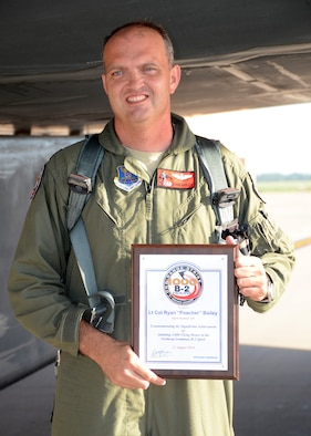B-2 Spirit pilot Lt. Col. Ryan Bailey, 131st Bomb Wing, Missouri Air National Guard, shows the certificate of achievement recognizing his 1000 flying-hour milestone at the end of a B-2 training mission at Whiteman Air Force Base, August 23, 2014. (U.S. Air National Guard photo by Staff Sgt. Brittany Cannon)