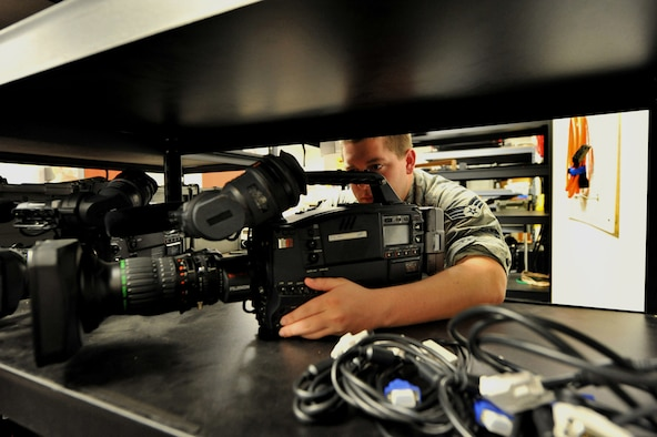 Senior Airman Lee Owens, former 42nd Air Base Wing broadcast engineer, performs a operations inspection on a video camera, July 24, 2014. Owens was one of more than 3,500 Airmen selected for separation after being identified by the Air Force's first Quality Force Review Board. After five years in uniform Owens faces rejoining the civilian sector. (U.S. Air Force photo by Master Sgt. Michael Voss)