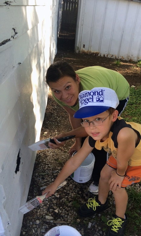Victoria Duncan, a U.S. Air Force Technical Sergeant, along with her son Ethan, volunteered their time to support the Omaha District Corps of Engineers Paint-A-Thon volunteers.