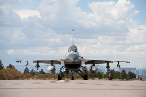 An F-16 Fighting Falcon from the 309th Fighter Squadron, Luke Air Force Base, Ariz., taxis to the runway during Green Flag-West 14-09 at Nellis AFB, Nev., Aug. 21, 2014. Green Flag exercises give visiting units the opportunity to train in air-to-ground combat operations. Many of the training exercise scenarios call for providing air support to ground troops who are participating in ground combat exercises. (U.S. Air Force photo by Airman 1st Class Thomas Spangler)