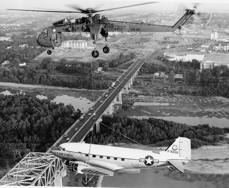 The Missouri Air National Guard's 131st Tactical Fighter Wing C-47 Gooney Bird on its final flight to the St. Louis Museum of Transportation in St. Louis, Missouri, courtesy of a Kansas Army National Guard CH-54 Sky Crane, July 12, 1974.  (131st Bomb Wing File photo/RELEASED).