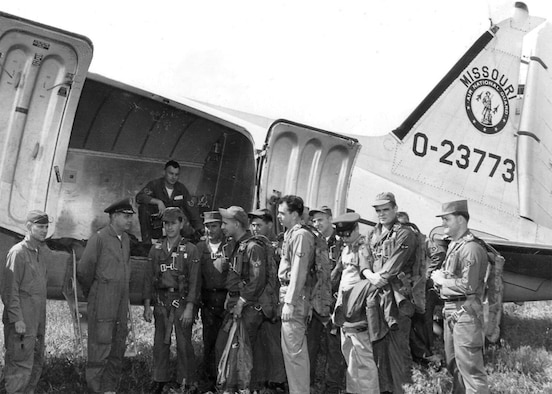 Col. Walter J. Weihe, 131st Wing commander, briefs maintenance Guardsmen and pilots prior to leaving for a training mission at Volk Field, Wisconsin. Utilizing the Gooney Bird's versatility and 28-man capacity, the Missouri Air Guard often transported Missouri Guardsmen to their training sites across the country. Circa 1961, Lambert-Saint Louis Air National Guard Base. (131st Bomb Wing File photo/RELEASED).
