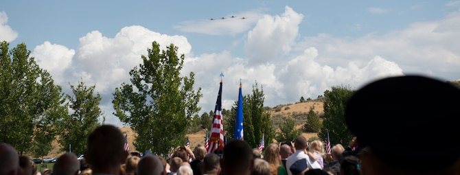 A flight of A-10s conducted a fly over for the late Col. (Ret.) Bernard Fisher, a Medal of Honor recipient at Idaho State Veterans Cemetery August 25, 2014, at Boise, Idaho. Fisher arrived at the 124th Fighter Interceptor Group (ANG), in Boise in July 1971 and retired from this assignment July 30, 1974, making Kuna his permanent home. (U.S. Air Force photo by Airman 1st Class Malissa Lott/RELEASED)