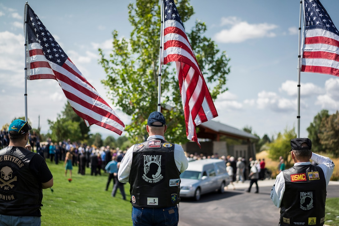 Patriot Guard members honor the late Col. (Ret.) Bernard Fisher, a Medal of Honor recipient at Idaho State Veterans Cemetery August 25, 2014, at Boise, Idaho. Fisher, who was born in San Bernadino, Calif., on January 11, 1927, grew up in Clearfield, Utah, and first called Kuna, Idaho, home after his discharge from the U.S. Navy V-6 program in 1946. (U.S. Air Force photo by Tech. Sgt. Samuel Morse/RELEASED)