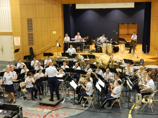 The Air National Guard Band of the Northeast, led by Senior Master Sergeant Donald Naumann, performs at the East Brookfield, MA Elementary School on July 3, 2014. (U.S. Air Force Photo/Technical Sgt. Dawn Hoffman)