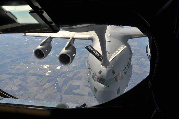 A C-17 Globemaster III receives fuel from a 507th Air Refueling Wing KC-135 Stratotanker in a recent training mission.  The 507th ARW received command responsibility for the 730th Air Mobility Training Squadron, the first classic associate unit in the Air Force. Reservists in the unit work next to active duty Airmen of the 97th Air Mobility Wing, training C-17 and KC-135 aircrew members for Air Education and Training Command. (U.S. Air Force Photo/Maj. Jon Quinlan)