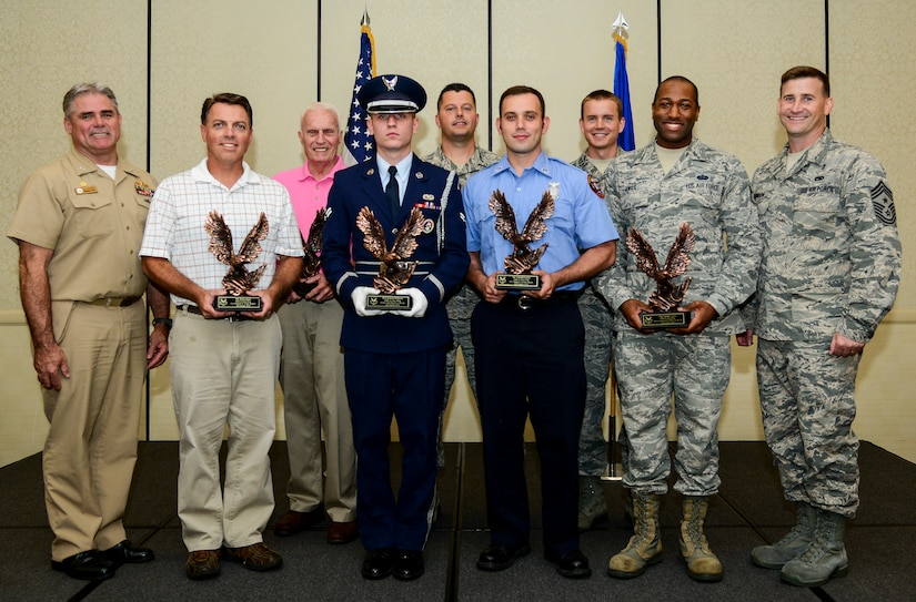 Capt. Timothy Sparks, Joint Base Charleston deupty commander (left), and Chief Master Sgt. Mark Bronson, 628th Air Base Wing command chief (right), congratulate (left to right) Brian Jones, Civilian Category II of the Quarter; Mr. Robert Hunt, Volunteer of the Quarter; Senior Airman Joshua Kilburn, Honor Guard Member of the Quarter;  Master Sgt. Ruebin Long, Senior Noncomissioned Officer in Charge of the Quarter; Carmel Lumia, Civilian Category I of the Quarter; Capt. Joshua Van Wyngaarden, Company Grade Officer of the Quarter; and Staff Sgt. Spenser Amos , Noncomissioned Officer of the Quarter Aug. 4, 2014, at the Charleston Club on JB Charleston. The Quarterly Awards are held to recognize outstanding Airmen, noncommisioned officers, senior noncomissioned officers, company grade officers and civilians for their hard work and dedication. (U.S. Air Force photo/Airman 1st Class Clayton Cupit)