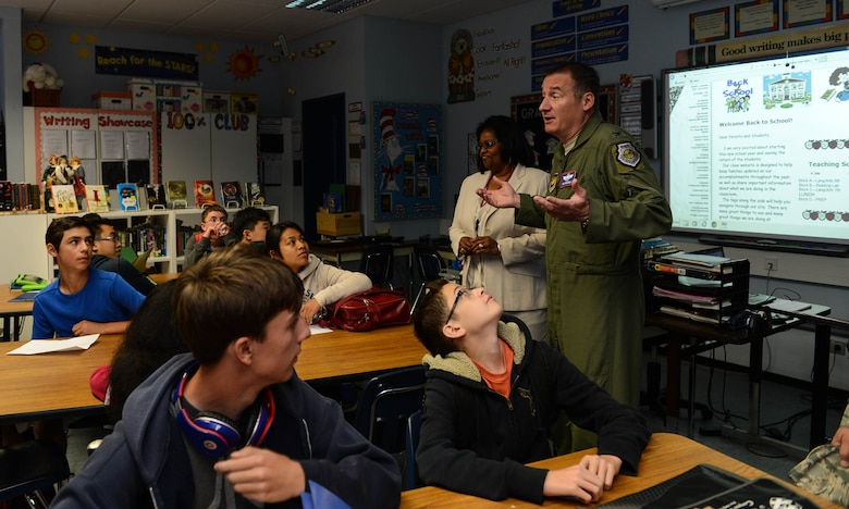 U.S. Air Force Col. Pete Bilodeau, 52nd Fighter Wing commander, talks with a class during the first day of school at Spangdahlem Air Base, Germany, Aug. 25, 2014. During a familiarization tour of the school, Bilodeau welcomed students and faculty while learning about the school's classes and programs. (U.S. Air Force photo by Airman 1st Class Kyle Gese/Released)