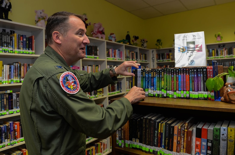 U.S. Air Force Col. Pete Bilodeau, 52nd Fighter Wing commander, visits the Spangdahlem Middle School library during the first day of school at Spangdahlem Air Base, Germany, Aug. 25, 2014. Bilodeau toured different classrooms to ask students if they were excited to begin the school year. (U.S. Air Force photo by Airman 1st Class Kyle Gese/Released)