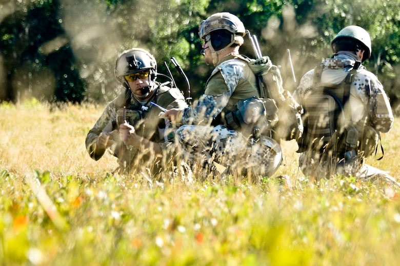 Master Sgt. John M. Oliver, (from left) Tactical Air Control Party specialist with the 169th Air Support Operations Squadron, Latvian 1st Sgt. Modris Circenis and Cpl. Janis Gabranis, TACPs with the Latvian National Armed Forces, make a plan to advance on an enemy position during a reconnaissance mission at Operation Northern Strike in Grayling Air Gunnery Range, Grayling, Mich., Aug. 14, 2014. (U.S. Air National Guard photo by Staff Sgt. Lealan Buehrer)