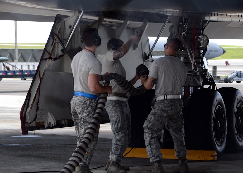 Airmen from the 509th Aircraft Maintenance Squadron work on a B-2 Spirit bomber during a deployment Aug. 22, 2014, at Andersen Air Force Base, Guam. The bombers and approximately 200 support Airmen, assigned to the 509th Bomb Wing at Whiteman Air Force Base, Mo., deployed to Guam to improve combat readiness and ensure regional stability. Bomber deployments help maintain stability in the region while allowing units to become familiar with operating in the theate. (U.S. Air Force photo/Senior Airman Cierra Presentado)