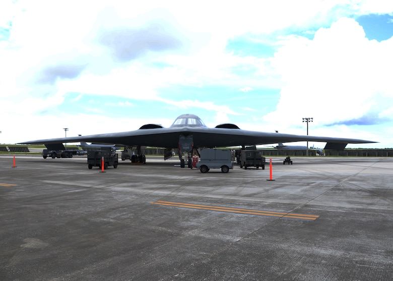 Airmen from the 509th Aircraft Maintenance Squadron work on a B-2 Spirit bomber during a deployment Aug. 22, 2014, at Andersen Air Force Base, Guam. The bombers and approximately 200 support Airmen, assigned to the 509th Bomb Wing at Whiteman Air Force Base, Mo., deployed to Guam to improve combat readiness and ensure regional stability. Bomber deployments help maintain stability in the region while allowing units to become familiar with operating in the theater. (U.S. Air Force photo/Senior Airman Cierra Presentado)