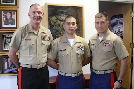 Gunnery Sgt. Anderson Olmos (center), SNCOIC of RSS Peekskill, received a Navy and Marine Corps Achievement Medal from Maj. Gen. Mark A. Brilakis (left), the Commanding General of Marine Corps Recruiting Command, Aug. 26, 2014. Olmos was identified for recognition by RS Albany's Commanding Officer, Maj. Mastin M. Robeson.