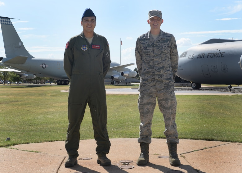 Staff Sgt. Trinidad Gutierrez, left, an instructor loadmaster with the 58th Airlift Squadron, and U.S. Air Force Senior Airman Bart Bolin, bioenvironmental engineering technician with 97th Medical Operations Squadron, stand together at Wings of Freedom Park, Aug. 25, 2014. Gutierrez and Bolin plan to run in the Air Force Marathon Sept. 20. (U.S. Air Force photo by Airman 1st Class Nathan Clark)