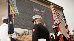 """Marines and a sailor, with a sea services color guard, observe the """"Undaunted in Battle"""" memorial in Bladensburg, Maryland Aug. 23, 2014. The monument was dedicated as a part of the 200 Year Commemoration of the Battle of Bladensburg."""