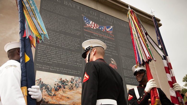 "Marines and a sailor, with a sea services color guard, observe the ""Undaunted in Battle"" memorial in Bladensburg, Maryland Aug. 23, 2014. The monument was dedicated as a part of the 200 Year Commemoration of the Battle of Bladensburg."