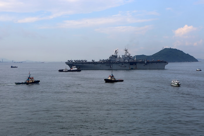 The USS Makin Island, embarked with Marines and sailors from the11th Marine Expeditionary Unit, remains anchored off the coast of Hong Kong, Aug. 23. The 11th MEU and Makin Island Amphibious Ready Group are deployed to the U.S. 7th Fleet area of operations as a sea-based, expeditionary crisis response force capable of conducting amphibious missions across the full range of military operations. (U.S. Marine Corps photo by Sgt. Melissa Wenger/Released)