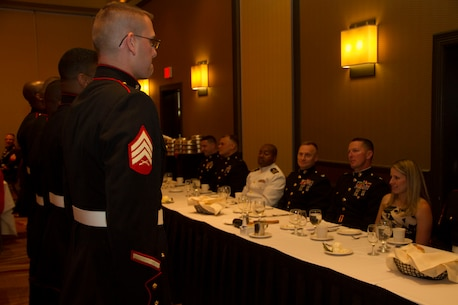 Sgt. Matthew Rardin and his fellow recruiters from Recruiting Substation North Milwaukee are called to the head table during Recruiting Station Milwaukee's first Dining Out, Aug. 20 in Brown Deer, Wis.  A Dining Out is conducted in the same manner as a traditional Mess Night but it is open to spouses and guests.