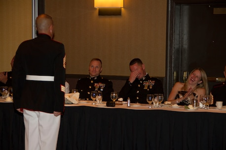 The head table reacts to Gunnery Sgt. Joshua Krause's, the Logistics Chief of Recruiting Station Milwaukee, rebuttal of the fine levied against him during RS Milwaukee's first Dining Out, Aug. 20 in Brown Deer, Wis.