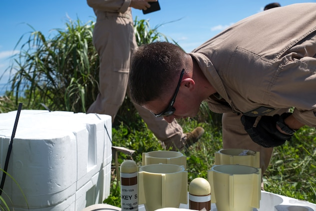 """Lance Cpl. Zachary Swisher, ordnanceman with Marine Aerial Refueler Squadron 152, inspects a GTR-18 missile, better known as a """"Smokey SAM,"""" during a threat reaction evolution on an island outside of Okinawa, Japan, Aug. 26, 2014. The threat reaction evolution is a chance for pilots to stay up to date on their qualifications while keeping an alert and aware mindset for any arising combat scenario."""