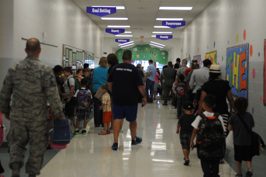 Students and parents queue in a hallway at Scott Elementary School at Scott Air Force Base, Ill. on August 13, 2014. The 2014-2015 school year began on August 13. (U.S. Air Force photo by Senior Airman Sarah Hall-Kirchner/Released)