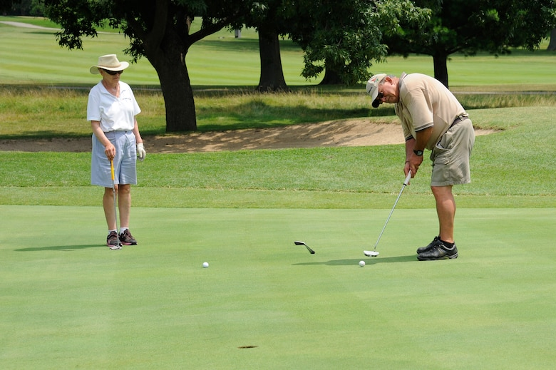 Ed and Linda Weisner play a game of golf at the Cardinal Creek Golf Club at Scott Air Force Base, Ill., Aug. 6, 2014. The Cardinal Creek re-opened its doors April 2014. (U.S. Air Force photo/Angelina Casarez)