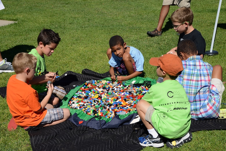PETERSON AIR FORCE BASE, Colo. – Several children play with Legos during the STEM Rocks! event Aug. 23 at the Peterson Air and Space Museum. Children and parents could visit nearly 30 booths to learn about Science, Technology, Engineering and Math in a fun, carnival-like environment. (U.S. Air Force photo/Tech. Sgt. Jared Marquis)