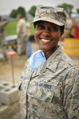 Air Force Tech. Sgt. Jeela Matthews, a member of the Tennessee Air National Guard's 134th Civil Engineer Squadron with the 134th Air Refueling Wing based in Knoxville, assists in the construction of a new building at the U.S. Coast Guard Academy in New London, Conn. Teamwork is highly emphasized in the military and service members are encouraged to work together to get tasks completed efficiently. U.S. Air National Guard photo by Air Force Staff Sgt. Ben Mellon, 134th Air Refueling Wing Public Affairs
