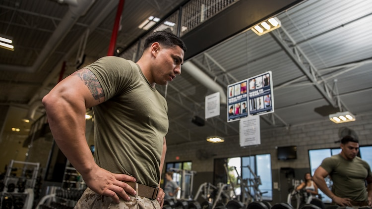 Corporal Freddy Cantu mentally prepares for his daily workout session aboard Camp Pendleton, Calif., on Aug. 25, 2014. Cantu, 22, is from Bakersfield, Calif., and is a cyber-network administrator for the 15th Marine Expeditionary Unit. (U.S. Marine Corps photo by Sgt. Emmanuel Ramos/Released)
