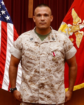 Master Sgt. Mark Carabello, operations and training chief, Operations and Training Division, Marine Corps Logistics Base Albany, receives the Meritorious Service Medal during his retirement ceremony at the Chapel of the Good Shepherd, here, Aug. 25.