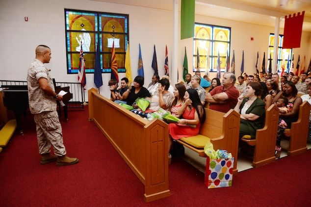 Master Sgt. Mark Carabello, operations and training chief, Operations and Training Division, Marine Corps Logistics Base Albany, speaks to spectators following his retirement ceremony at the Chapel of the Good Shepherd, here, Aug. 25. Carabello's emotional farewell speech marked the end of a 23 year active-duty career. He also received a Meritorious Service Medal.