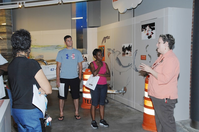 Lisa Lofton, program coordinator, Thronateeska Heritage Center, tells of survival and rescue stories during the 1994 flood in Albany, Ga., to the public affairs staff during a recent visit.