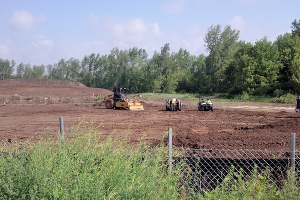 Contractors work to consolidate waste and create a soil cover at the Lockbourne landfill in Columbus, Ohio.