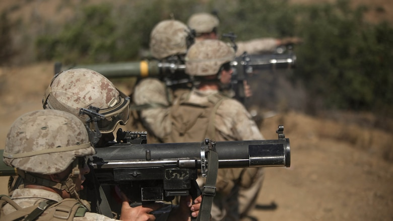 Lance Cpl. Scott Wern, an assaultman with Company E, 2nd Battalion, 5th Marine Regiment, and fellow Marines prepare to fire a volley of rockets aboard Marine Corps Base Camp Pendleton, Calif., Aug. 22, 2014. The Marines performed the rocket drills to  sustain of the Marine's operational abilities.