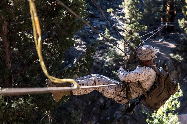 U.S. Marine 2nd Lt. Hunter Harrison makes his way across a gorge suspended more than 100 feet above ground while training to build and cross rope bridges during Mountain Exercise 2014 aboard Marine Corps Mountain Warfare Training Center in Bridgeport, Calif., Aug. 27, 2014. Harrison is a platoon commander with 2nd Platoon, India Company, 3rd Battalion, 1st Marine Regiment. Marines with 3rd Battalion, 1st Marine Regiment will become the 15th Marine Expeditionary Unit's ground combat element in October. Mountain Exercise 2014 develops critical skills the battalion will need during deployment.