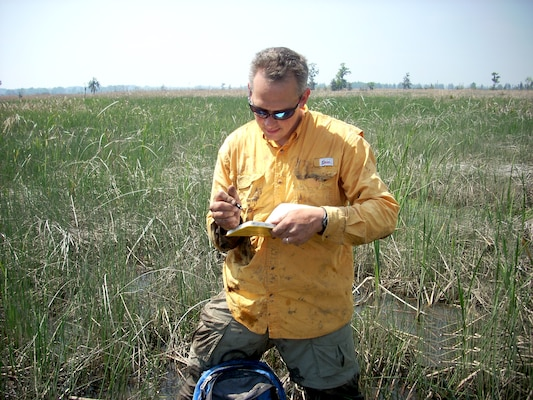 Jamie Duberstein, Clemson research assistant professor, records data at a marsh site in the Savannah River estuary, April 2, 2014.