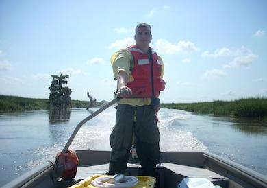 Josh Salter, Clemson research technician, navigates a research vessel in the Savannah River estuary, June 16, 2014.