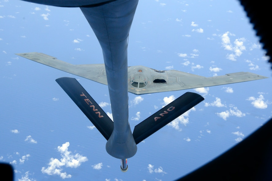 A B2 Stealth Bomber is refueled by a KC135-R Stratotanker from the 134th Air Refueling Wing, Tennessee Air National Guard over the Pacific during a training mission.  (U.S. Air National Guard photo by Staff Sgt. Ben Mellon, 134 ARW Public Affairs)
