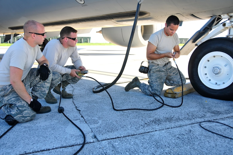 Aircraft Maintainers from the 134th Air Refueling Wing, McGhee Tyson ANG Base, TN check the tire pressure on a KC-135R Stratotanker refueling aircraft at Andersen AFB, Guam during a training mission.  (U.S. Air National Guard photo by Staff Sgt. Ben Mellon, 134 ARW Public Affairs)