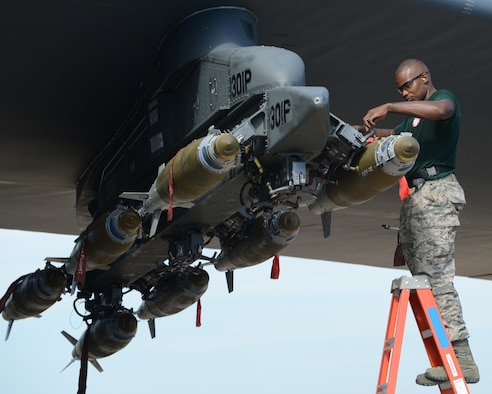 Staff Sgt. Stefano Cothran, 2nd Aircraft Maintenance Squadron weapons load team, secures a GBU-38 to a pylon during the 2014 Global Strike Challenge on Barksdale Air Force Base, La., Aug. 27. The goal of the challenge is to showcase the world's premier bomber force and foster esprit de corps through competition and teamwork. (U.S. Air Force photo/Senior Airman Benjamin Gonsier)