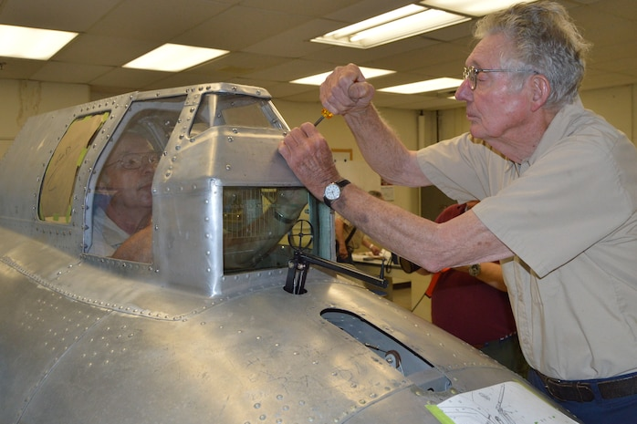 """DAYTON, Ohio (08/2014) – Museum volunteers working on the """"Memphis Belle"""" in the restoration hangar at the National Museum of the U.S. Air Force. (U.S. Air Force photo)"""