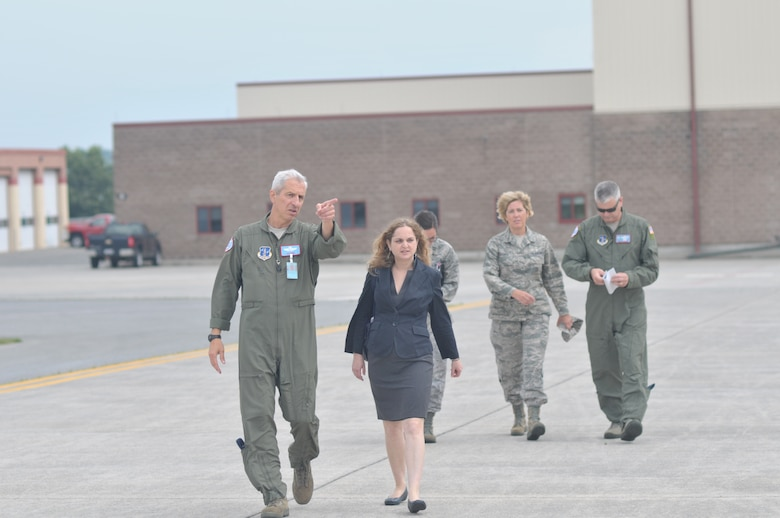 Lt. Col. Alan Ross, 109th Airlift Wing chief of staff, points out an LC-130 aircraft to to Moran Banai, military legislative assistant to Sen. Kirsten Gillibrand. Banai came to Stratton Air National Guard Base, Scotia, N.Y., on Aug. 27, 2014, to learn more about the 109th's unique mission and tour an LC-130 aircraft. (U.S. Air National Guard photo by Master Sgt. William Gizara/Released)