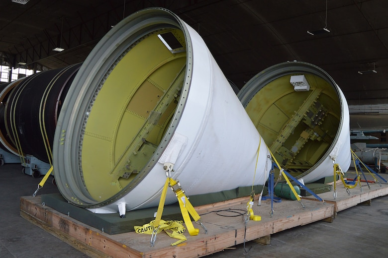 DAYTON, Ohio -- The Titan IVB space launch vehicle in the restoration hangar at the National Museum of the United States Air Force. These are the nose cones from the solid rocket motor units. (U.S. Air Force photo)
