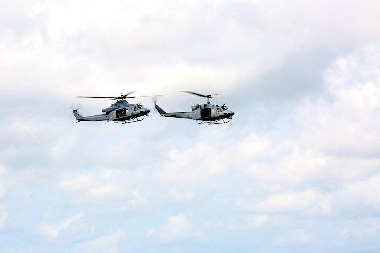 The UH-1N Huey (Right) escorts a UH-1Y Venom (Left) during the final flight of the UH-1N Huey for Marine Light Attack Helicopter Squadron 773, Marine Aircraft Group 49, aboard Naval Air Station Joint Reserve Base, New Orleans, Aug. 28, 2014. The escort symbolizes the stepping aside of one helicopter platform to allow for an improved version to takes its place.